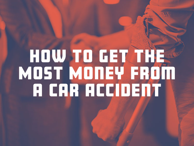 Injured car accident victim with crutch meeting with a car accident lawyer